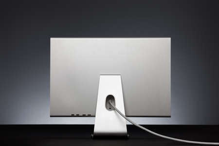 Stylish silver monitor. Rear view