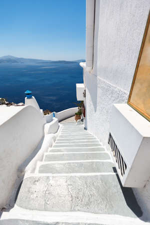 Hotel stairs leading to the terrace with beautiful sea view. Oia, Santorini island, Greece photo