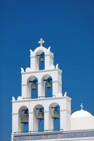 free stock: Church Panagia Of Platsani, Oia, Santorini, Greece Royalty Free Stock Photo Find Similar Files Download a Comp Save to Lightbox The bell tower of the Church of Panagia Of Platsani in the Oia village, Santorini island, Greece  Stock Photo