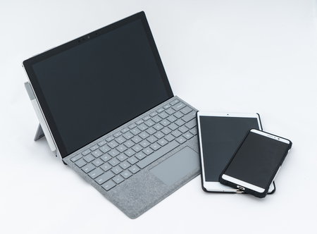 laptop computer and cell phone  isolated Imagens