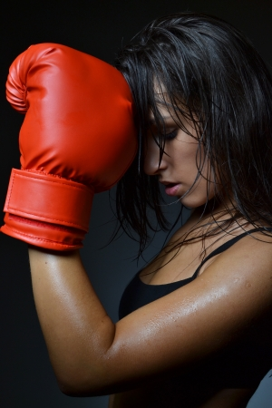 modern fighter: beautiful woman with the red boxing gloves, studio shot Stock Photo