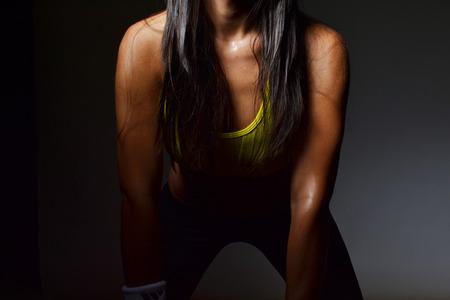woman black background: fitness woman, studio shot Stock Photo