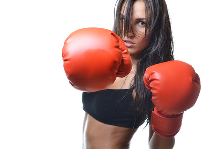beautiful woman with the red boxing gloves, isolated on white background photo