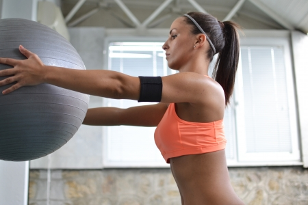beautiful fitness woman with exercise ball