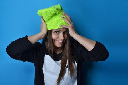 beautiful woman wearing hoodie, studio shot photo