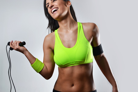 active: beautiful fitness woman with the jump rope Stock Photo