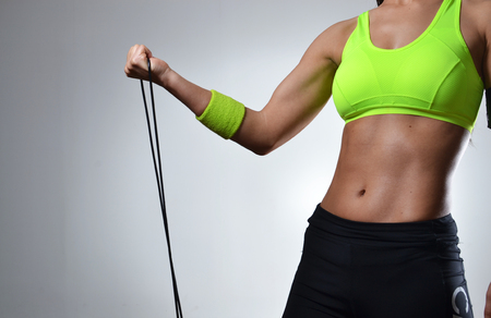 beautiful fitness woman with the jump rope Stock Photo