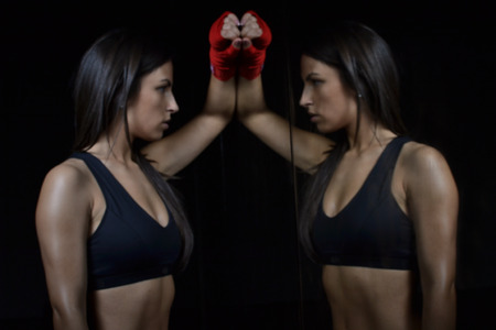female boxing:  beautiful fitness woman with the red boxing bandage Stock Photo