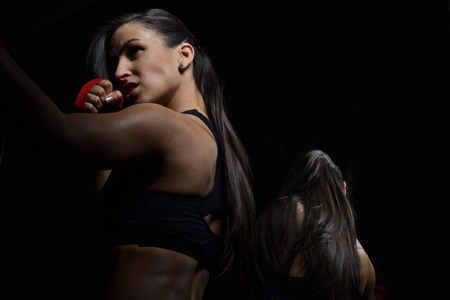 beautiful fitness woman with the red boxing bandage Stock Photo