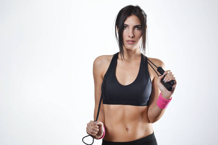 woman rope: beautiful fitness woman with the jump rope Stock Photo