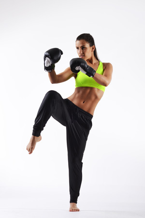 female boxing: beautiful fitness woman with the black boxing gloves