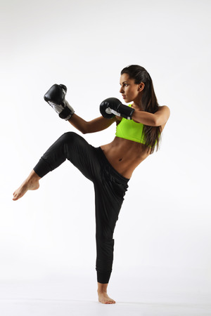 beautiful fitness woman with the black boxing gloves photo