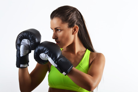 beautiful fitness woman with the black boxing gloves, close up Stock Photo
