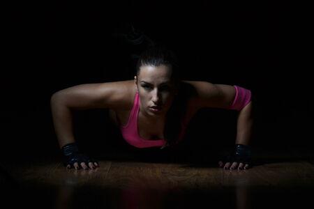 beautiful fitness woman working out, studio shot photo