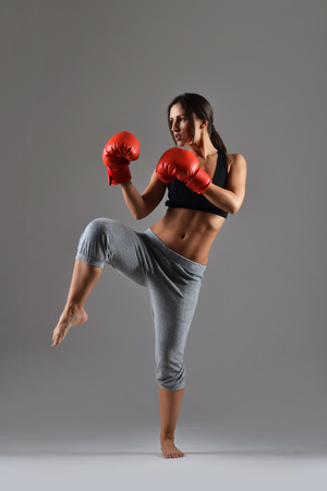 female boxing: beautiful fitness woman with the red boxing gloves Stock Photo