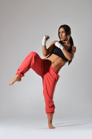 female boxing: beautiful fitness woman with the white boxing bandage