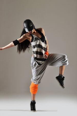 hip hop style: beautiful young woman dancing, studio shot Stock Photo