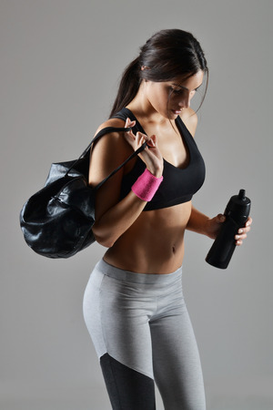 beautiful fitness woman with bag Stock Photo