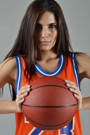 beautiful woman with the basketball, studio shot photo