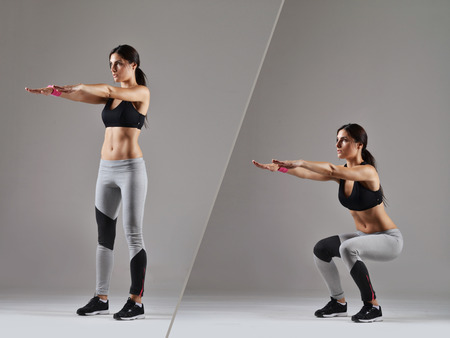 squats: beautiful fitness woman working out Stock Photo