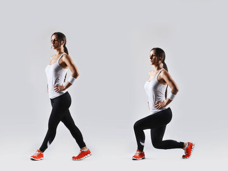 lunges: beautiful fitness woman working out, studio shot