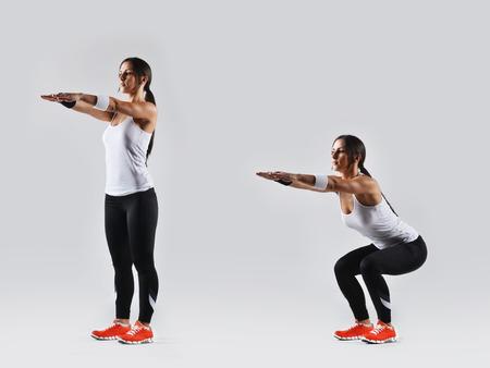 squats: beautiful fitness woman working out, studio shot