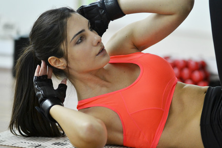 Beautiful young woman working out in the fitness