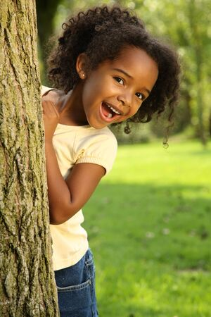 afro girl: Child having fun in a park Stock Photo