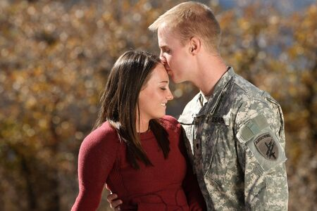 wife: American Soldier kissing his girlfriend