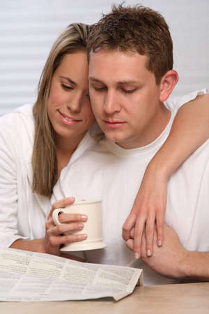 Young couple reading newspaper Stock Photo - 2837858