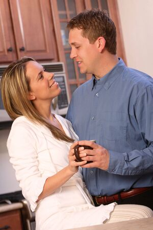 Young couple having morning coffee Stock Photo - 2837868
