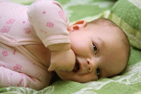 Toddler Lying on a Bed