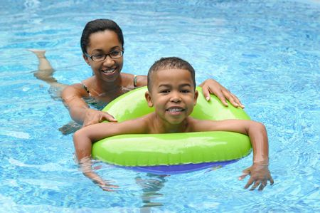Mother and child in a swimming pool Stock Photo