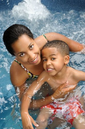 Mother and child in a swimming pool Stok Fotoğraf