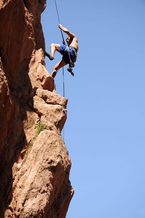 rappelling: Rock Climber Rappelling  Stock Photo