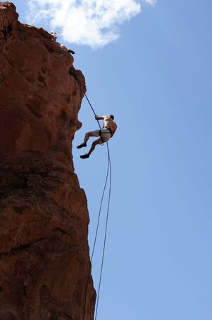 Rock Climber Rappelling  photo