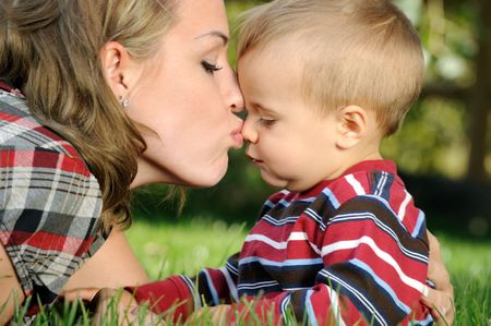 Mother Kissing her Child photo