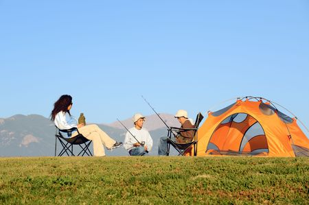 camping tent: Happy Family Camping Stock Photo