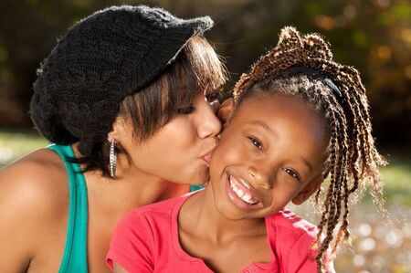 african american mother and daughter: Mother Kissing her Daughter