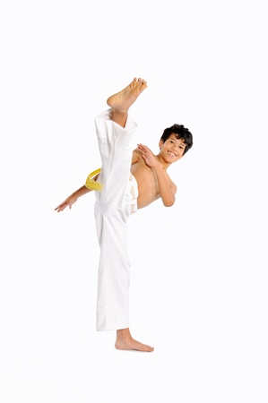 Child performing Brazilian martial art dance - Capoeira