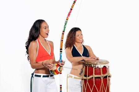 Girls performing Brazilian martial art dance - Capoeira
