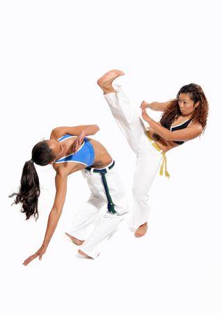 girl kick: Girls performing Brazilian martial art dance - Capoeira