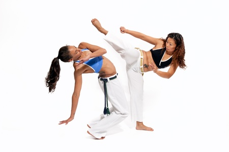Girls performing Brazilian martial art dance - Capoeira