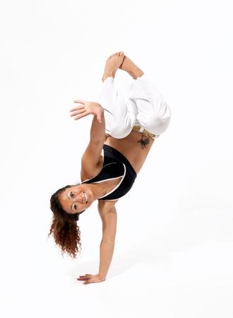 Girl performing Brazilian martial art dance - Capoeira