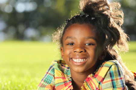 green and black: Happy child relaxing in a park