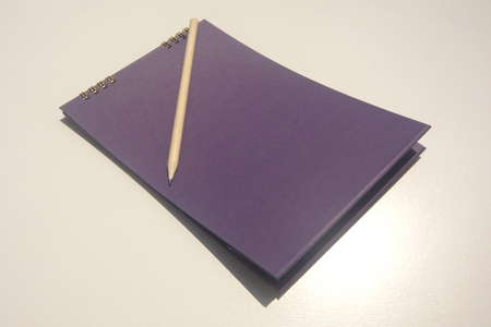 purple notebook with pencil photo