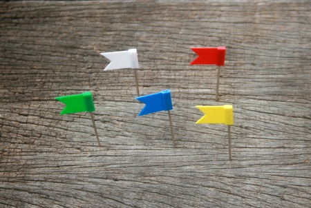 pinning: color flag pin on wood Stock Photo