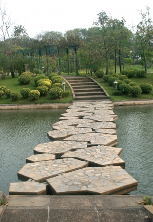 stone bridge in beautiful garden photo