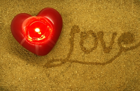 text love written by hand in sand photo