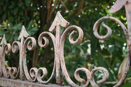 demarcation: a garden fence in front of a house